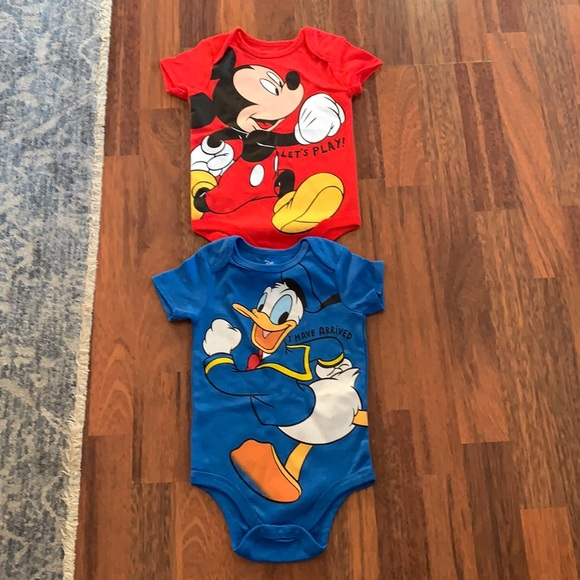 (2) never used Disney Baby onesies size 18 months